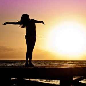 Woman Breathing in Sunset