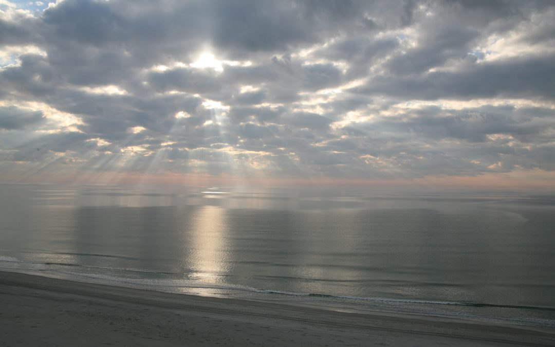 tranquil sunrise/calm ocean