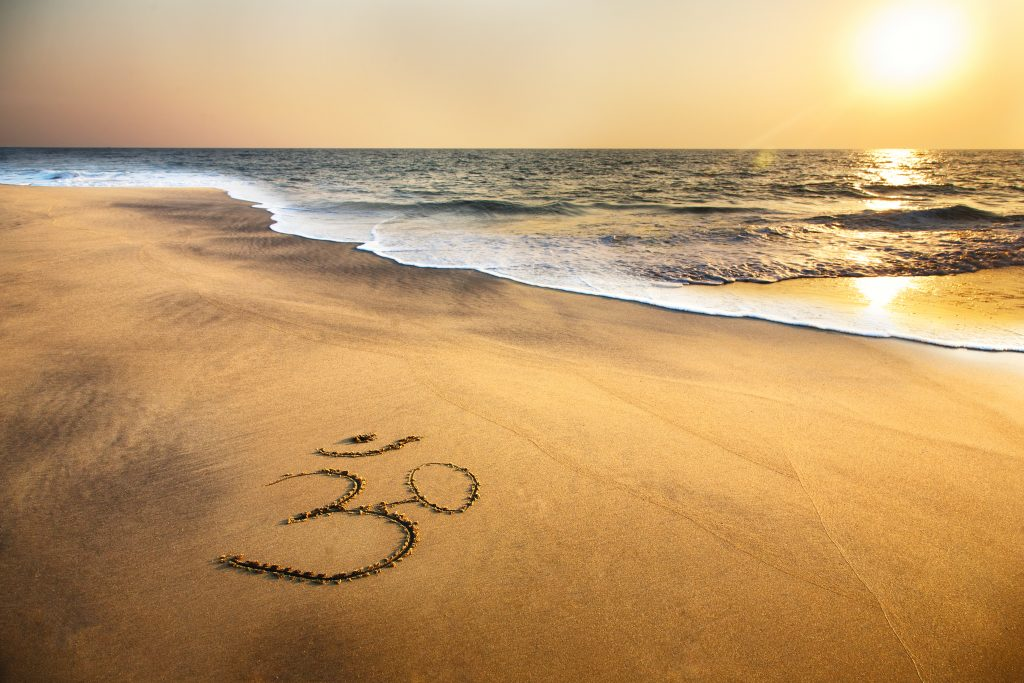 OM symbol on beach