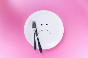 frowning plate, with knife and fork